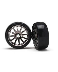 Latrax 7573A Tires & wheels, assembled, glued (12-spoke black chrome wheels, slick tires) (2) 1/18